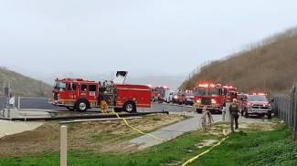 Morto Kobe Bryant, vigili del fuoco sul luogo dell'incidente (Ansa)